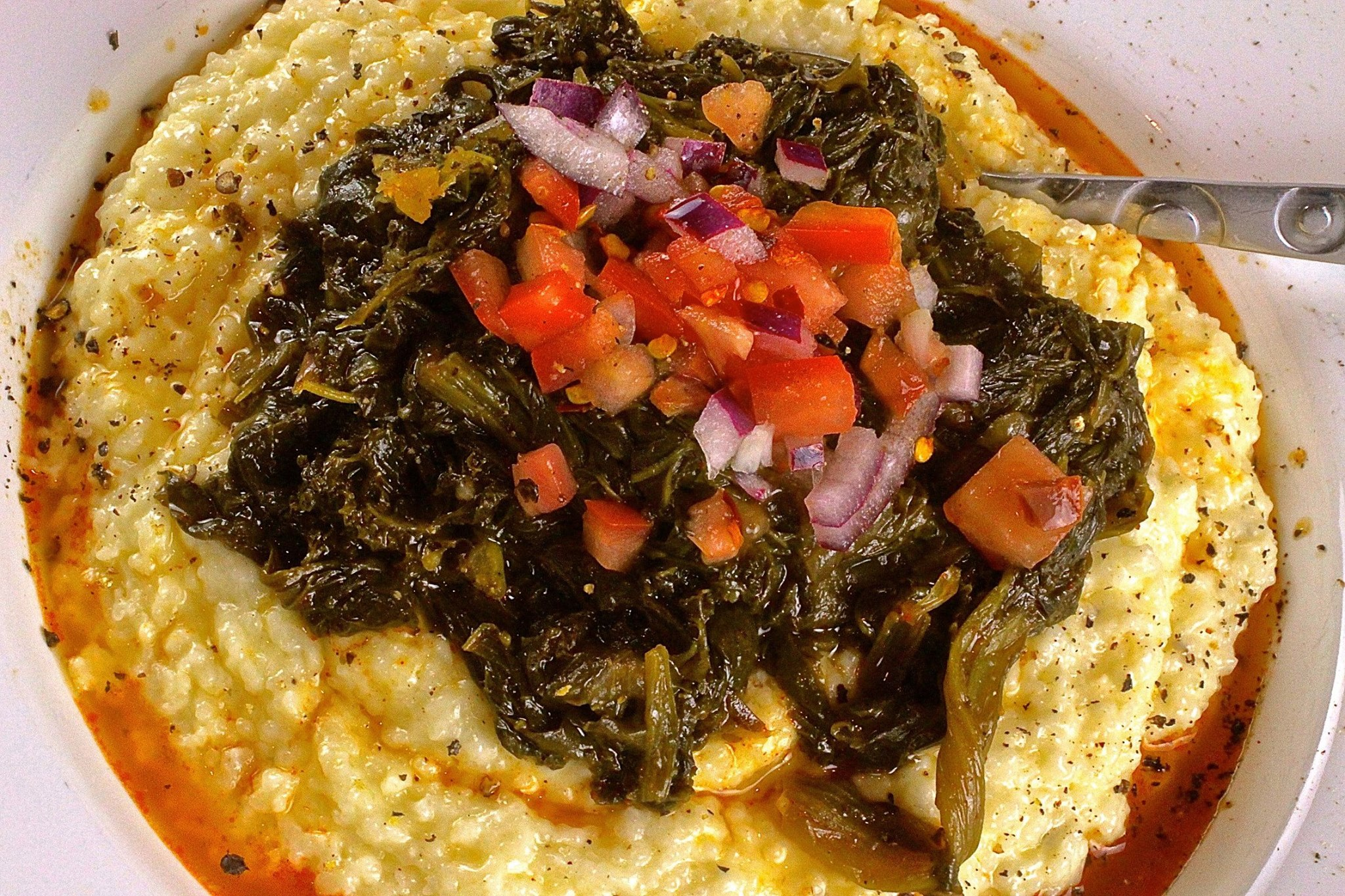 Slow Braised Greens over Pepper Jack Grits